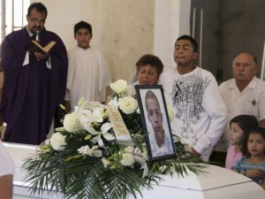Relatives cry beside a coffin containing Jose Antonio Elena Rodriguez, 16, during his funeral in Nogales, Mexico. Photo Source: Reuters