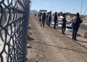 Members of the Border Network for Human Rights protest punitive and unaccountable enforcement against communities at the border fence between the U.S. and Mexico in El Paso on Human Rights Day, Dec. 10, 2012.